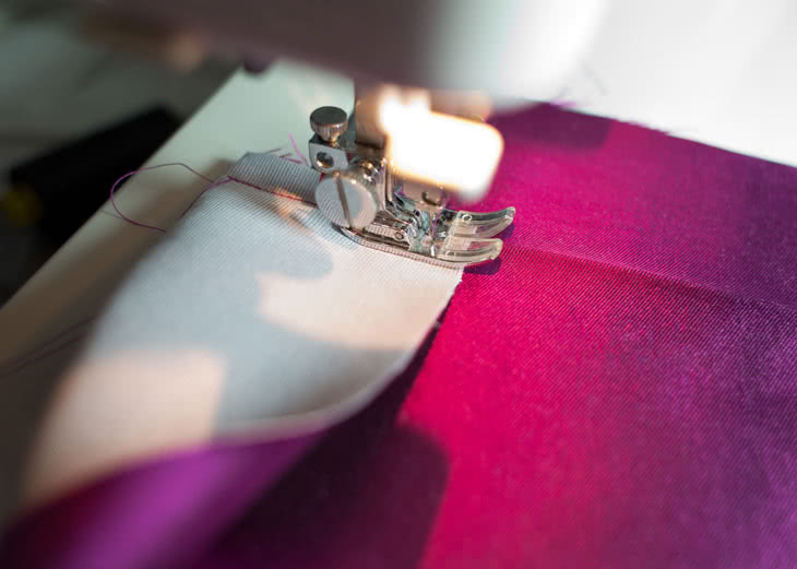 Begin sewing, starting from the foldline of the long folded edge.