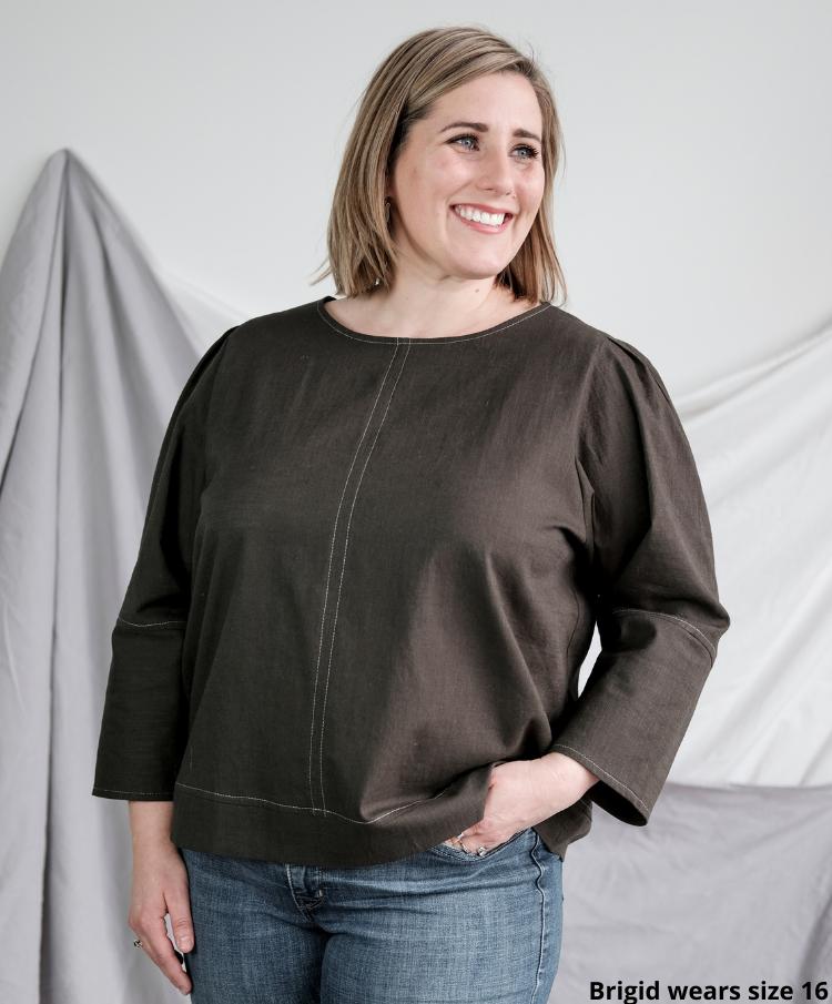 Brigid wearing Florence woven top in khaki in size 16