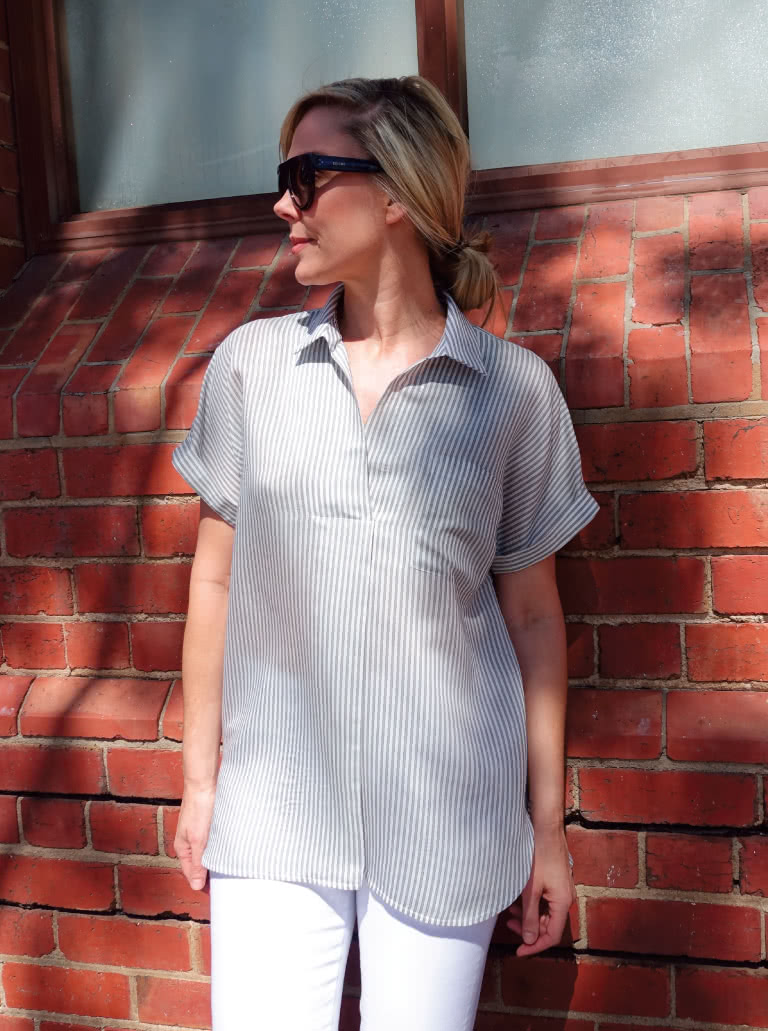 Hayward Tunic By Style Arc - Pleat front loose fitting tunic featuring a shirt collar and extended shoulder line.