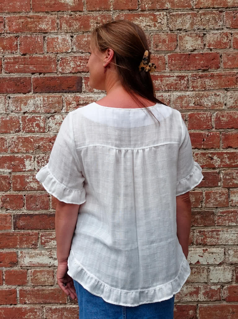 "Selina Woven Top By Style Arc - Slip on ""A"" line easy fit top featuring sleeve and hem frills."